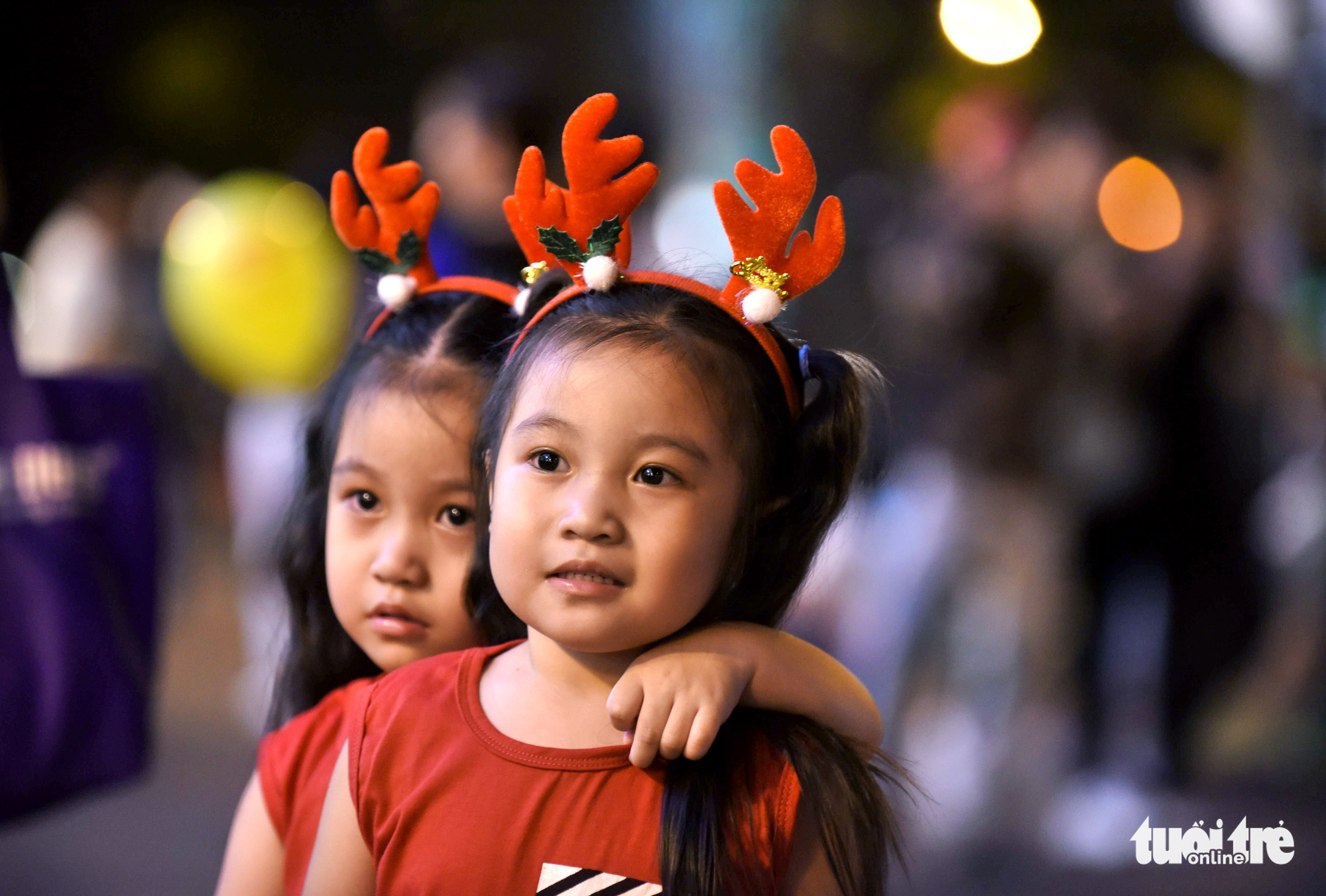 Two little girls are dressed in their holiday outfits in Ho Chi Minh City on Christmas Eve, December 24, 2019.