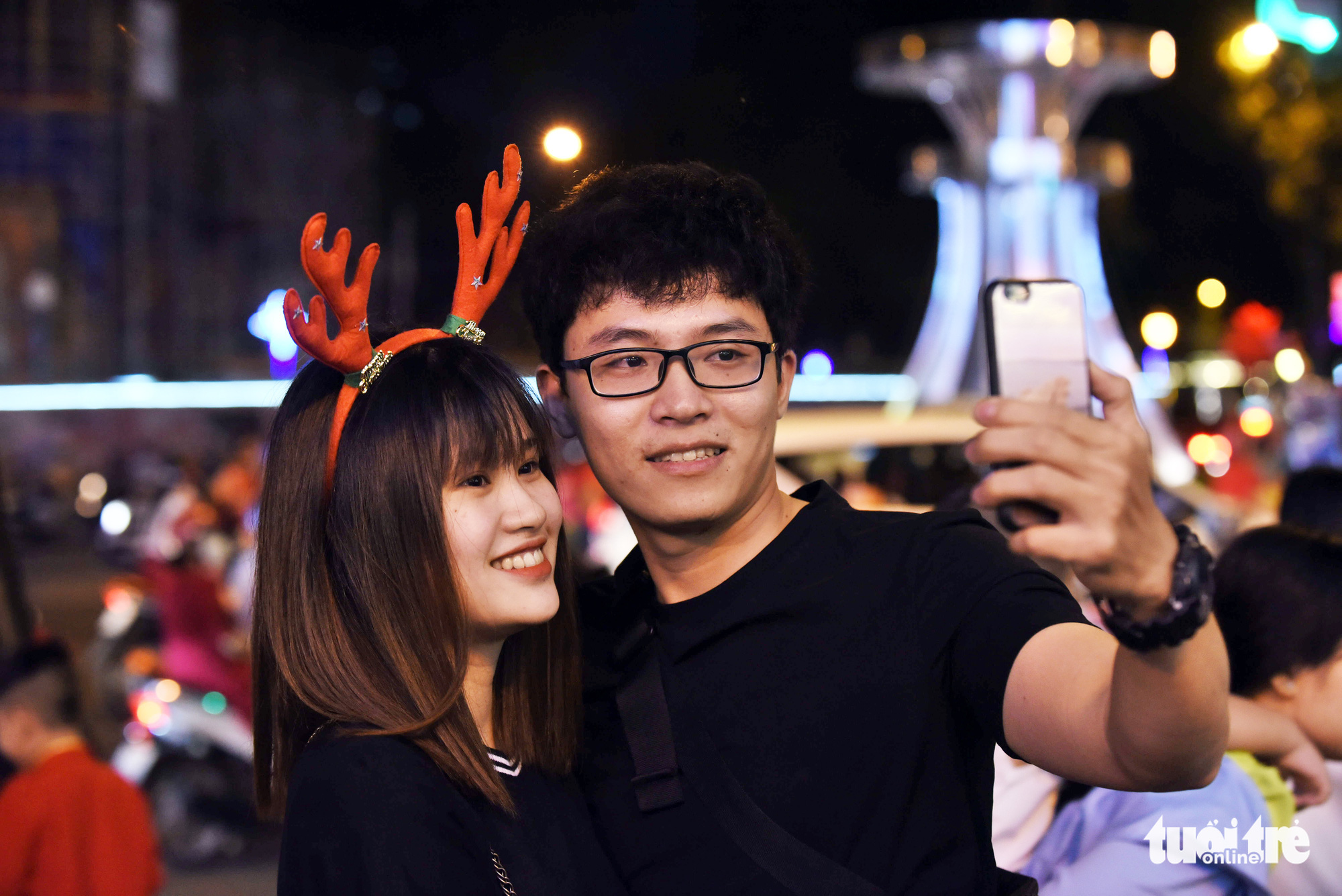 A young couple takes a selfie in Ho Chi Minh City on Christmas Eve, December 24, 2019.