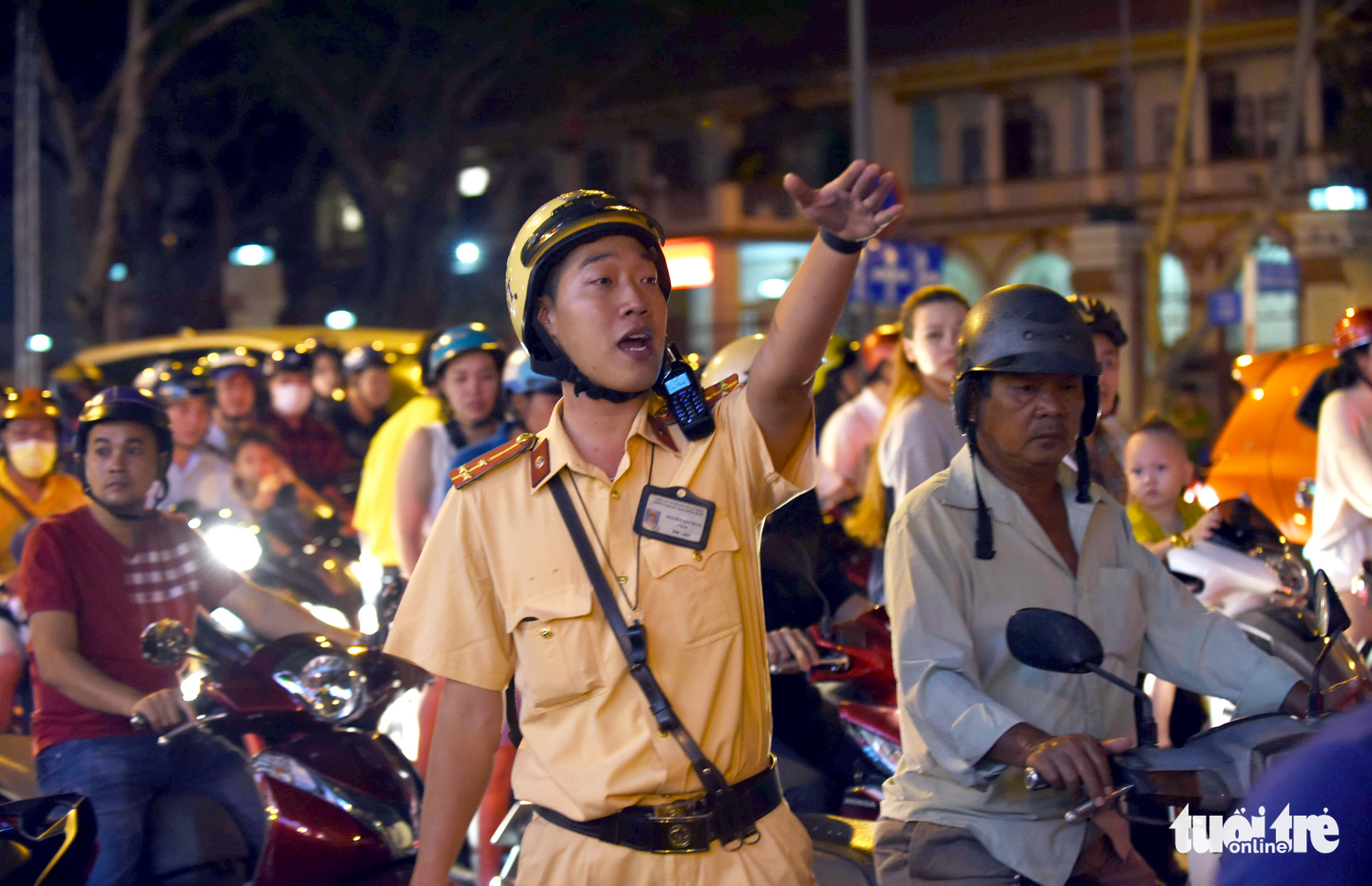 A traffic police officer regulates traffic in downtown Ho Chi Minh City on Christmas Eve, December 24, 2019.
