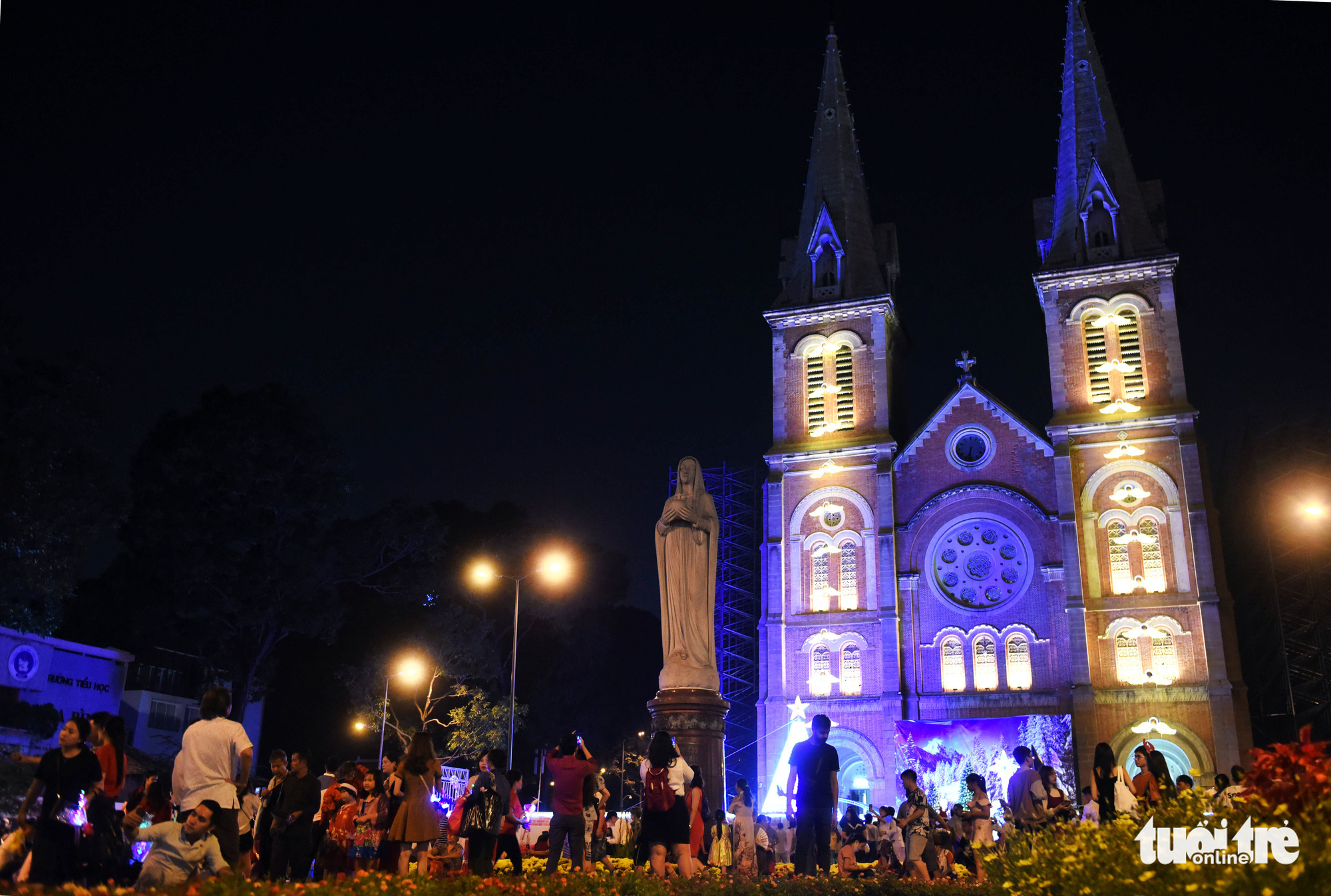 People celebrate Christmas Eve in front of the Saigon Notre Dame Cathedral in downtown Ho Chi Minh City on December 24, 2019.