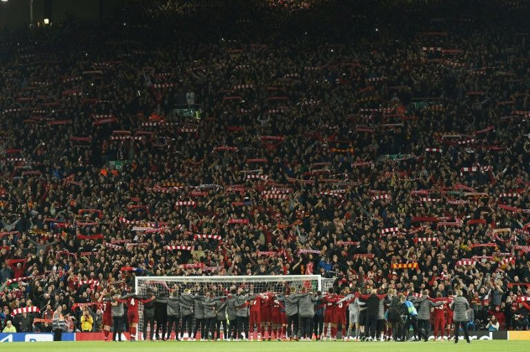 After scoring four goals to beat Barcelona, all of the Liverpool squad and the Kop saluted each other.