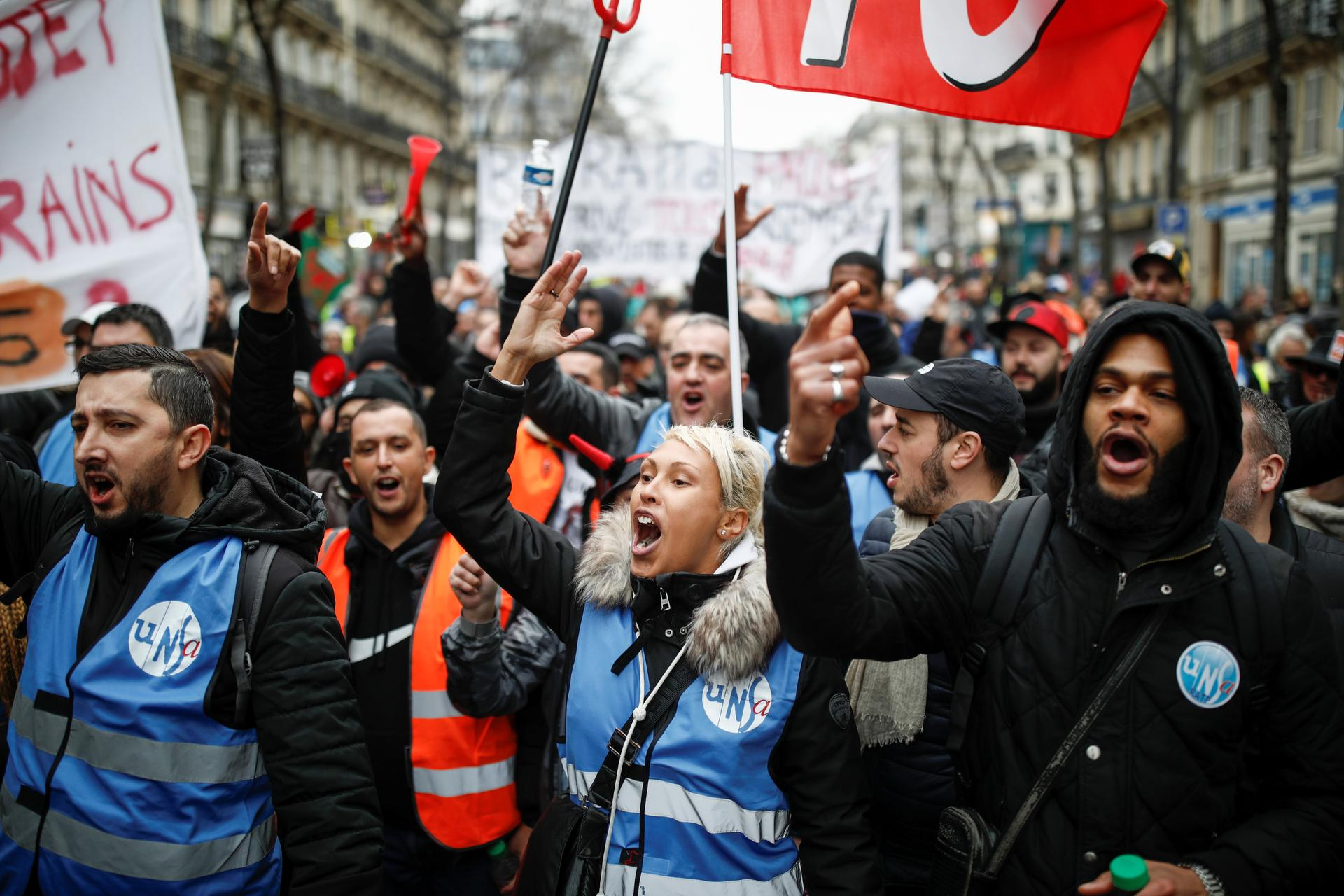 Scuffles break out in Paris as pensions protesters, 'yellow vests' march