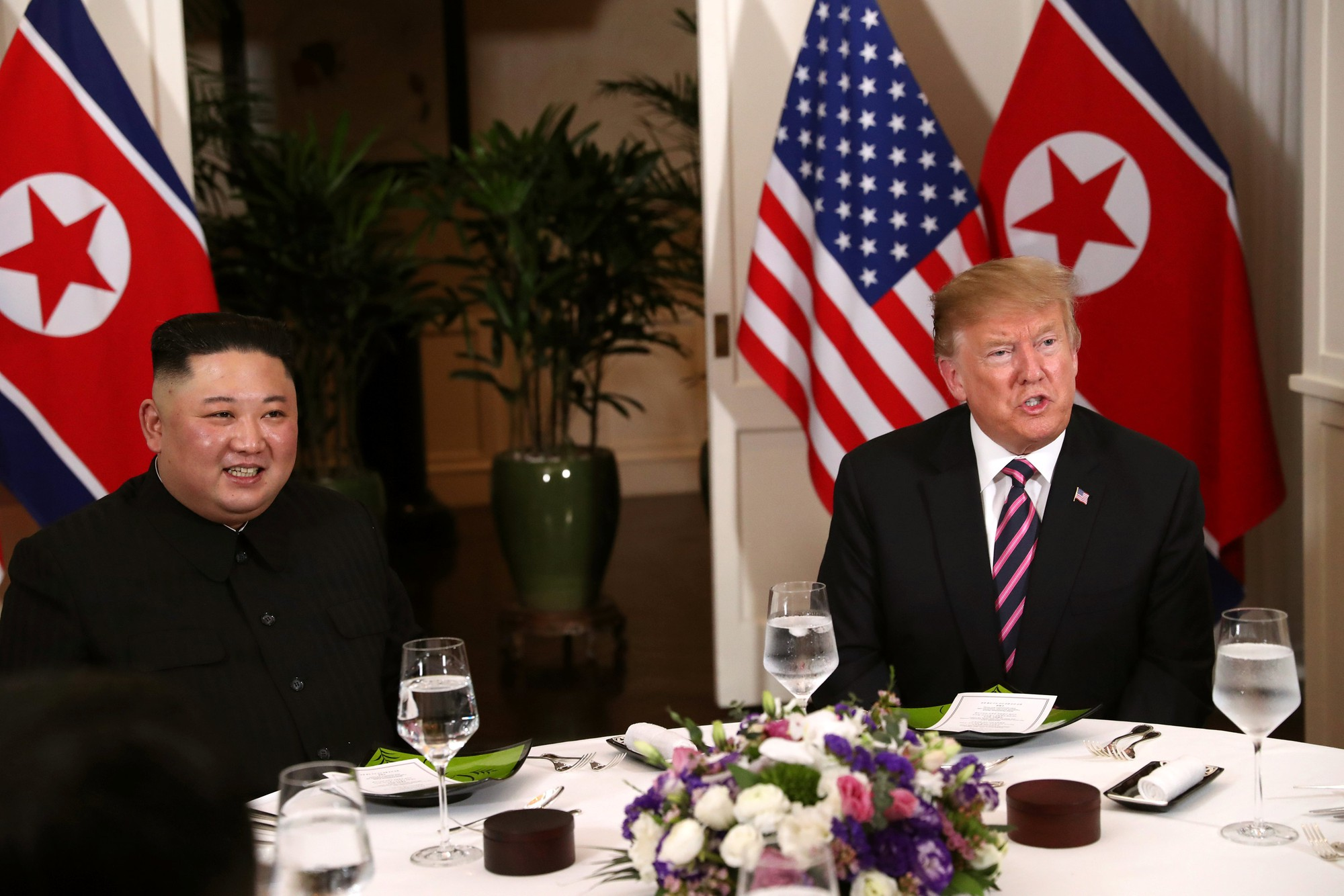 North Korean leader Kim Jong Un and United States President Donald Trump have dinner following their brief meeting in Hanoi on February 27, 2019. Photo: Reuters