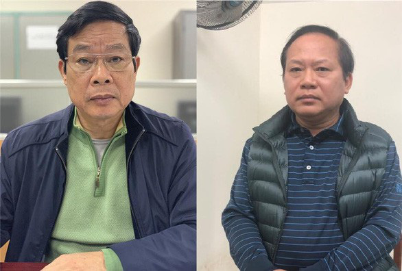 Nguyen Bac Son (L) and Truong Minh Tuan, former minsters of Information and Communications. Photo: Ministry of Public Security