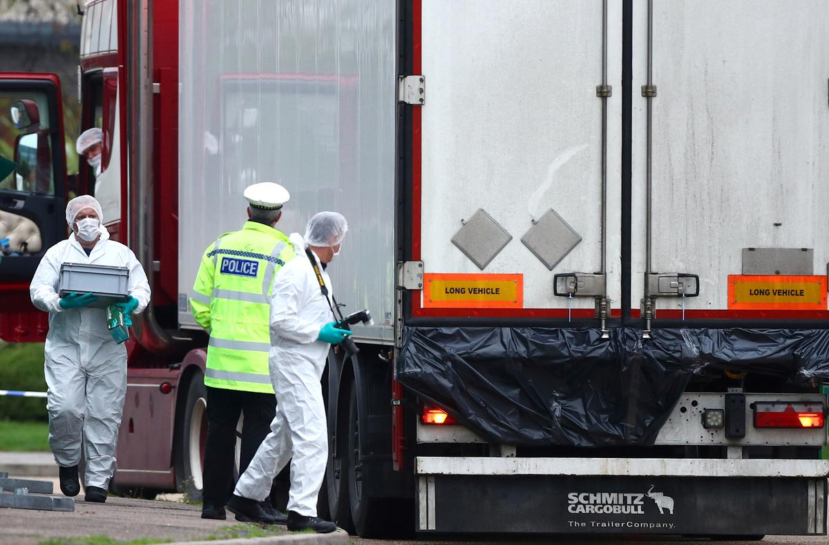 Police are seen at the scene where bodies were discovered in a lorry container, in Grays, Essex, Britain October 23, 2019. Photo: Reuters