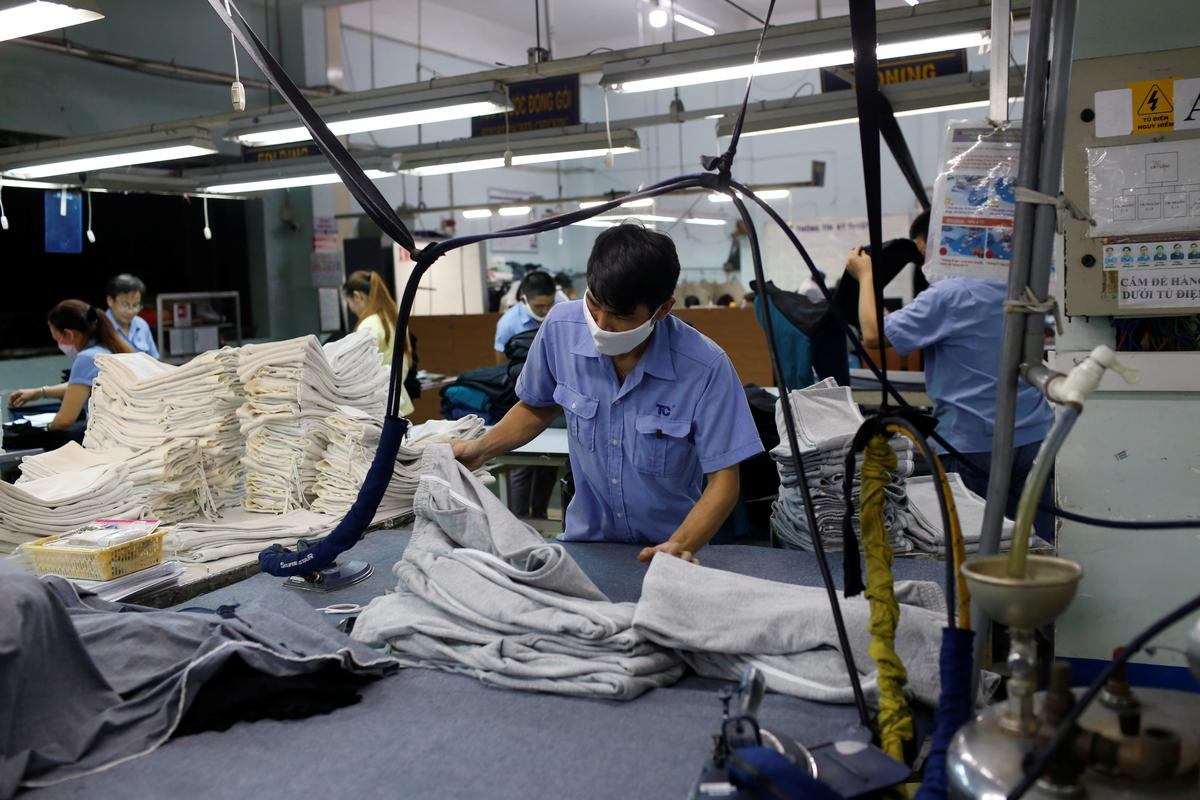 A man works at a garment assembly line of Thanh Cong textile, garment, investment and trading company in Ho Chi Minh city, Vietnam July 9, 2019. Picture taken July 9, 2019. Photo: Reuters