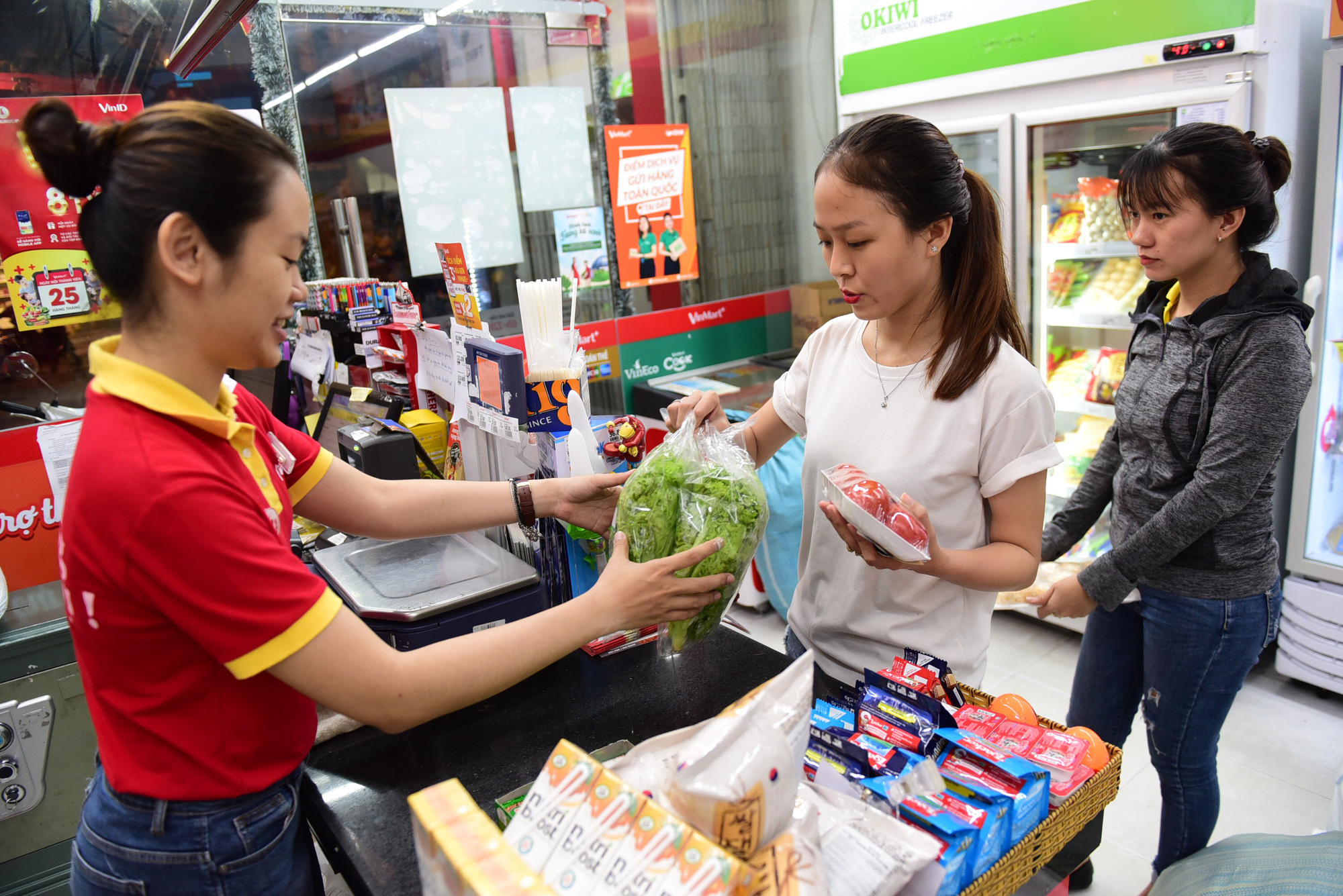 Shoppers check out at a counter in a VinMart+ convenience store in Ho Chi Minh City, Vietnam. Photo: Quang Dinh / Tuoi Tre
