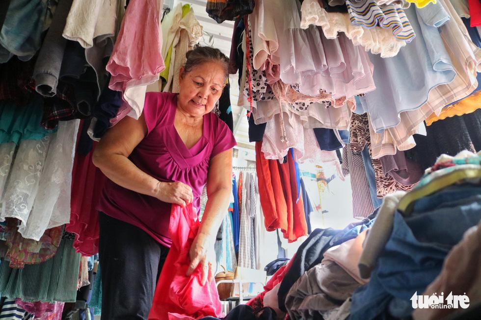 Le Thi Be runs the brick-and-mortar clothing store at an alley on Nguyen Van Tao Street in Nha Be District, Ho Chi Minh City. Photo: Ngoc Phuong / Tuoi Tre