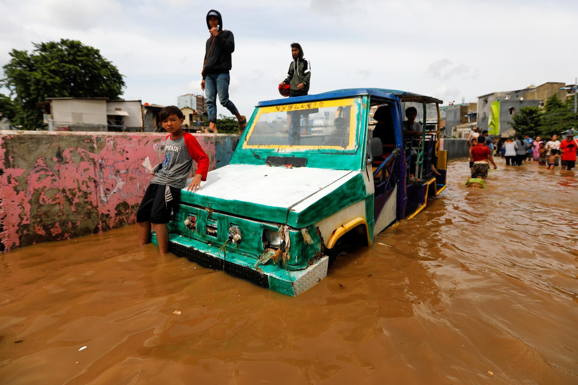 Indonesia plans cloud seeding to halt rain as floods death toll hits 30