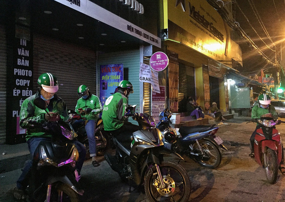 Vietnam mulls limit on students' part-time working hours as rideshare drivers