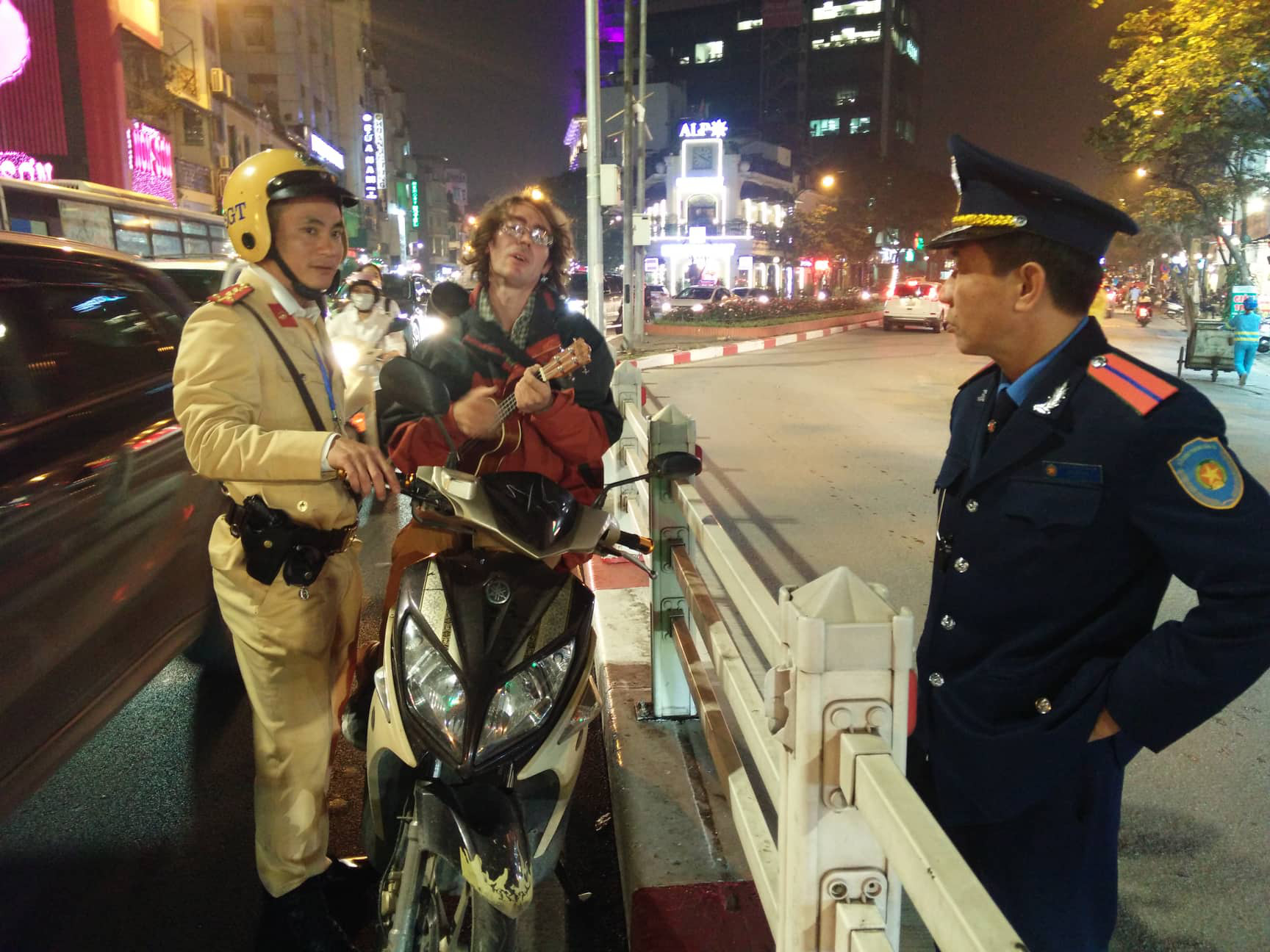 Russian man plays ukulele after pulled over by traffic police in Hanoi