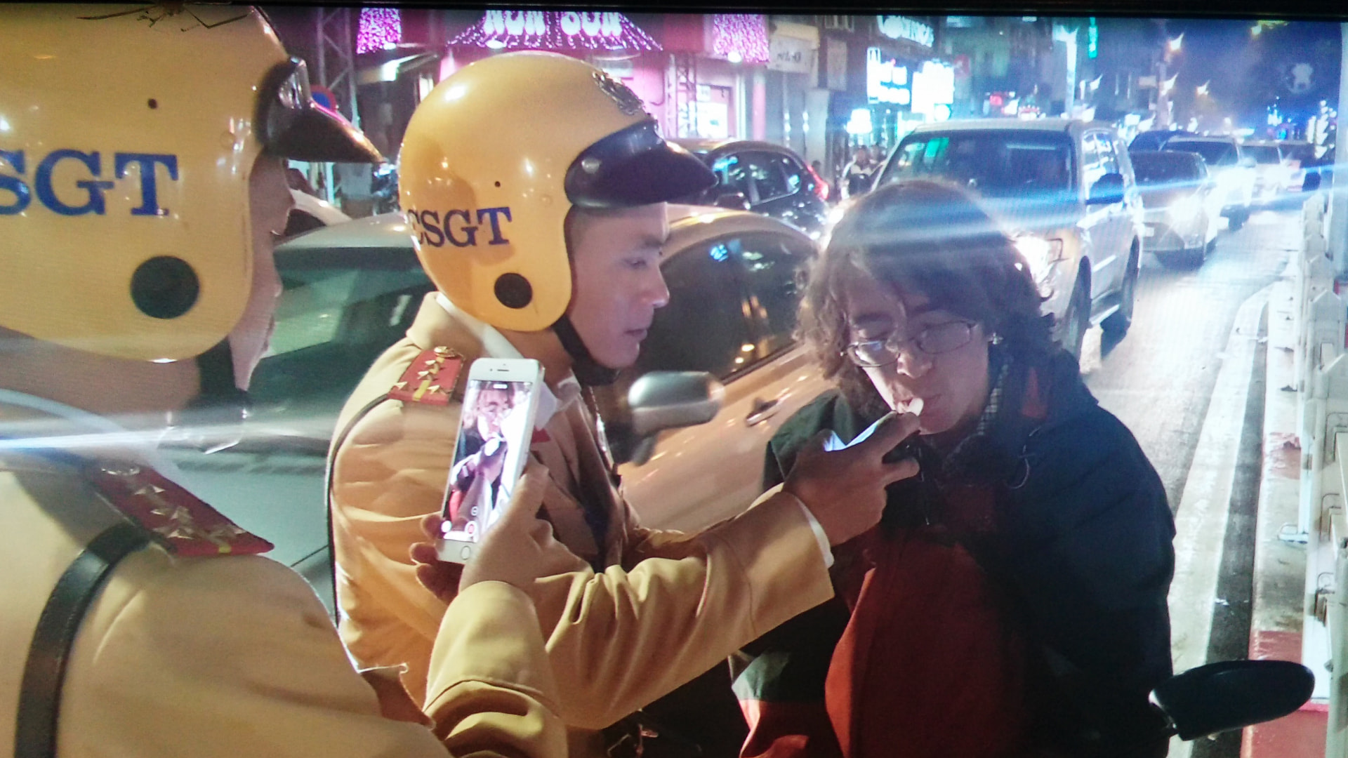 Russian Aleks Ivanov takes a breathalyzer test after being stopped by traffic police in Hanoi on January 7, 2020. Photo: Xuan Bui / Tuoi Tre