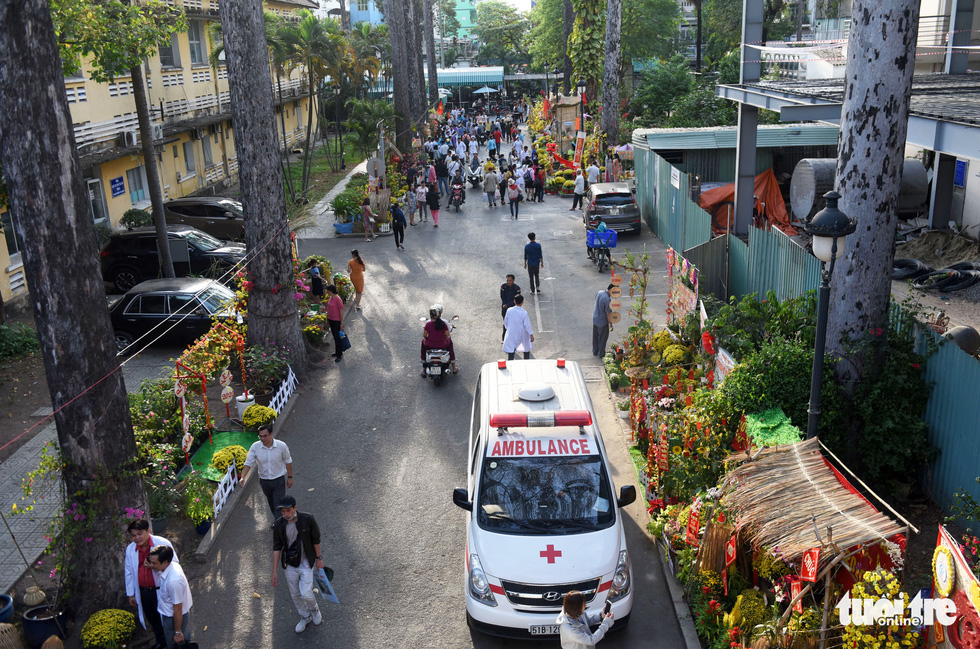 People walk along the 'flower road' at Cho Ray Hospital in Ho Chi Minh City. Photo: Duyen Phan / Tuoi Tre