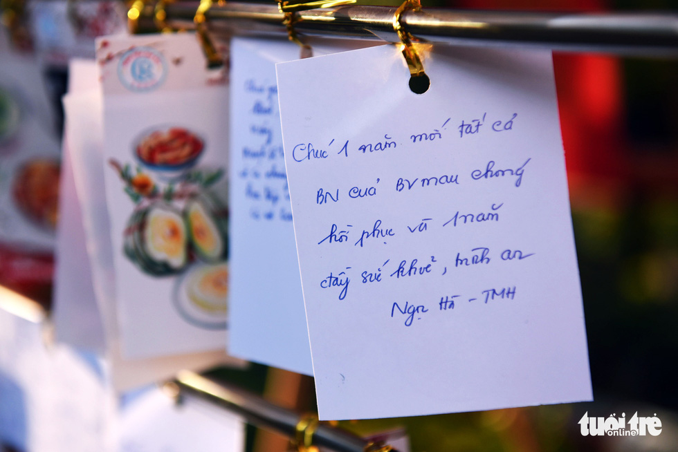 Best wishes are hung along the 'flower road' at Cho Ray Hospital in Ho Chi Minh City. Photo: Duyen Phan / Tuoi Tre