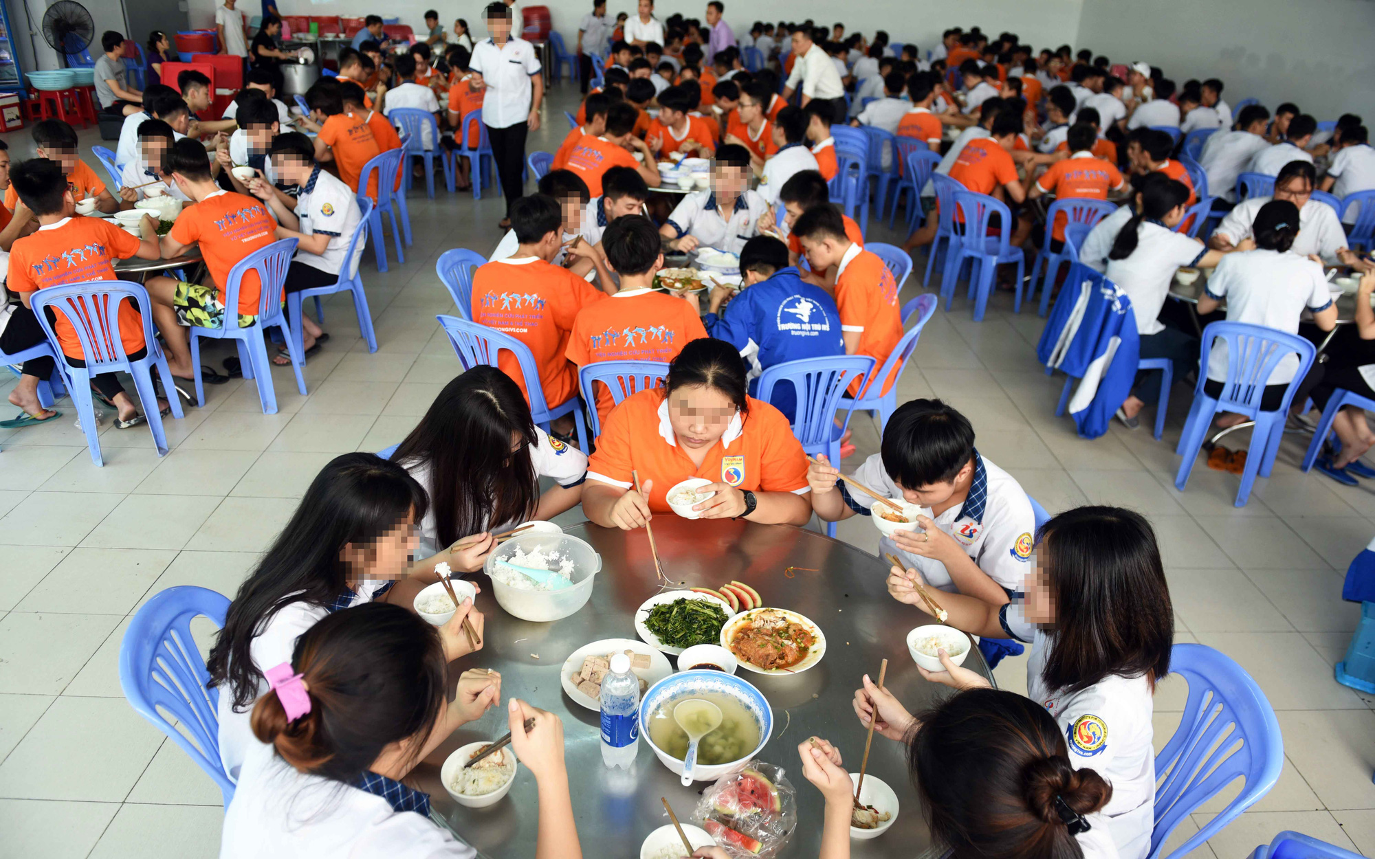 Students have meal at the IVS boarding school in District 12, Ho Chi Minh City. Photo: Duyen Phan / Tuoi Tre