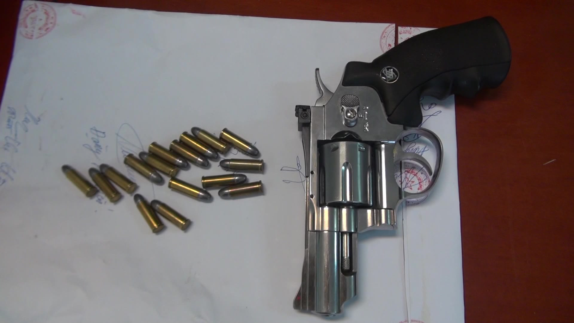 A pistol and bullets are seized from the residence of drug suspect Tran Hoai Nam in Nghe An Province, Vietnam. Photo: Dinh Hop / Tuoi Tre