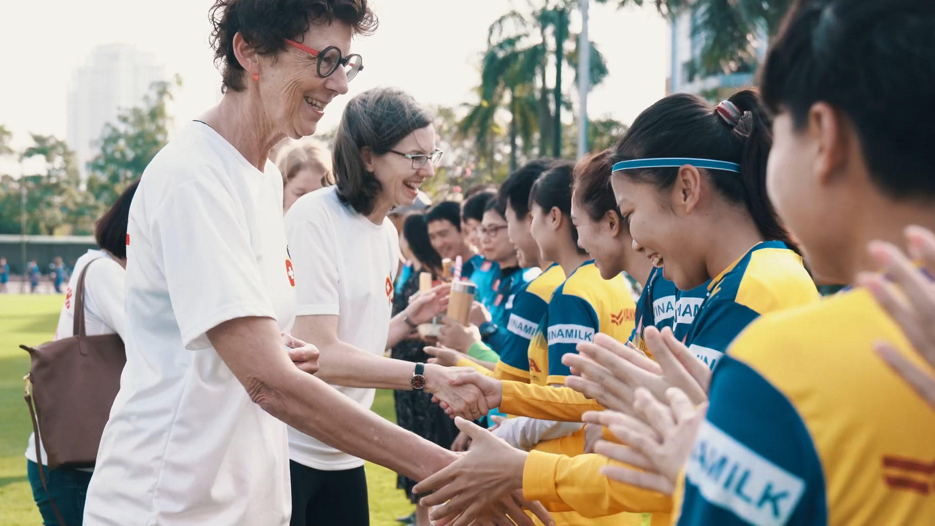 Ambassadors of New Zealand, Canada, Norway, and Switzerland shake hands with players of the women's national football team of Vietnam in this screengrab taken from a videoed Tet message sent to the media on January 20, 2020.