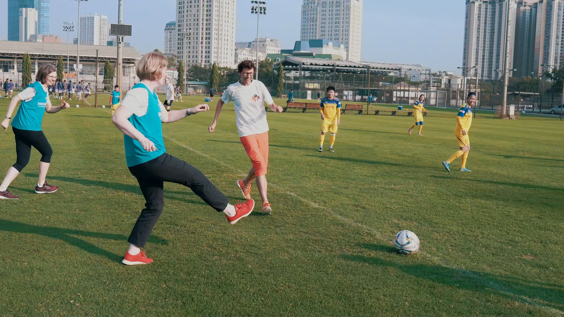 Ambassadors of New Zealand, Canada, Norway, and Switzerland play football with players of the women's national football team of Vietnam in this screengrab taken from a videoed Tet message sent to the media on January 20, 2020.