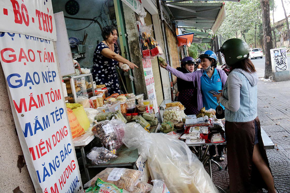Buyers find northern products at Nguyen Thi Kim Lien's store in Ho Chi Minh City. Photo: Ngoc Hien / Tuoi Tre