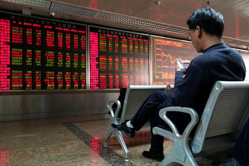 Global stocks steady as caution on China virus continues; euro hits seven-week low after ECB