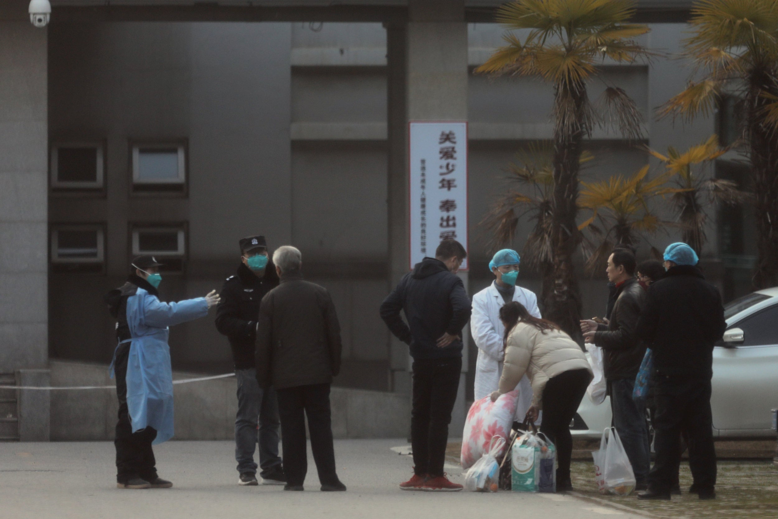 Medical staff and security personnel stop patients' family members from being too close to the Jinyintan hospital, where the patients with pneumonia caused by the new strain of coronavirus are being treated, in Wuhan, Hubei province, China January 20, 2020. Photo: Reuters