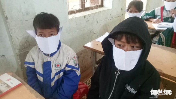In rural Vietnam, students don DIY face masks made from notebook paper amid coronavirus scare