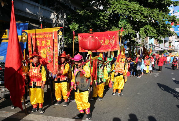 <em>A parade at the First Full Moon Festival, or Tet Nguyen Tieu, on a street in District 5, Ho Chi Minh City.</em>