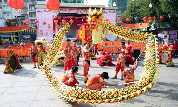 <em>People perform a dragon dance at the First Full Moon Festival, or Tet Nguyen Tieu, on a street in District 5, Ho Chi Minh City.</em>