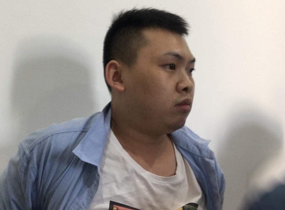 Xiao Qui Ping is investigated at the police in the central city of Da Nang on February 7, 2020, in this supplied photo
