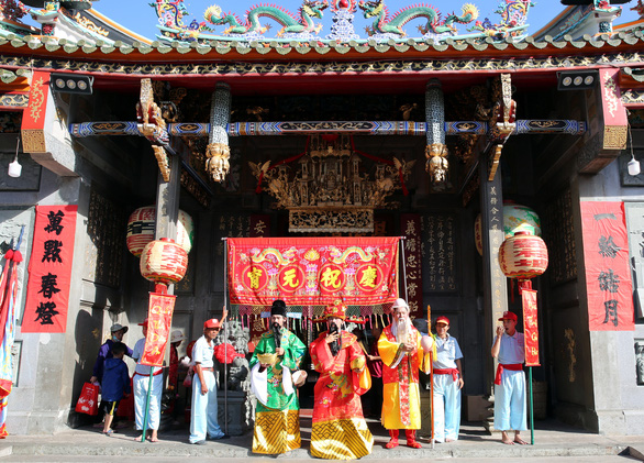 <em>People dress up as three Chinese deities Fu, Lu, and Shou at the First Full Moon Festival, or Tet Nguyen Tieu, at Nghia An Pagoda in District 5, Ho Chi Minh City.</em>