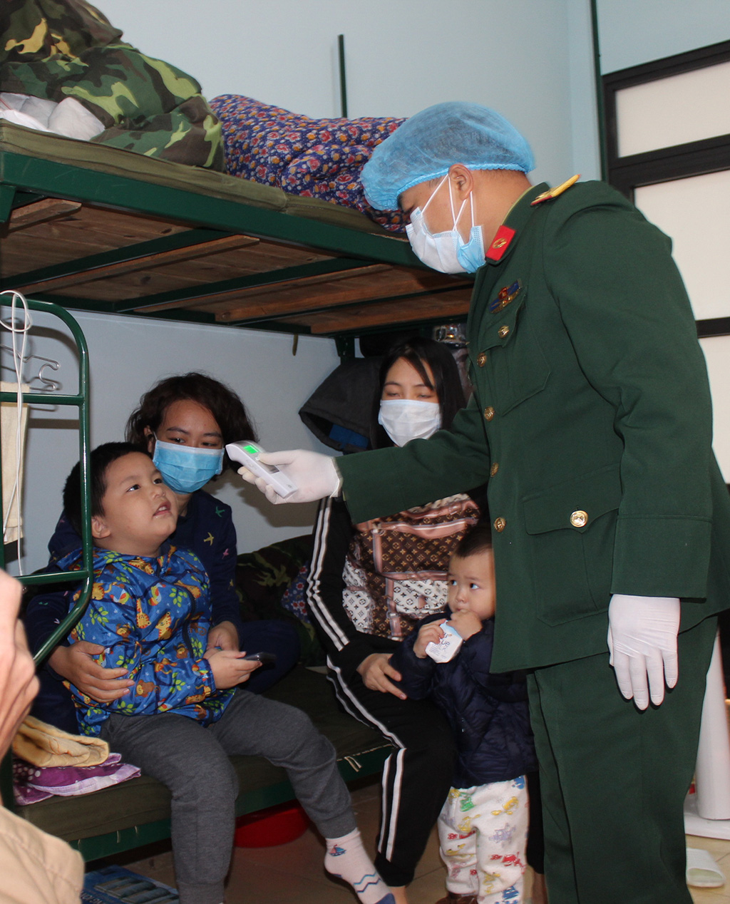 Vietnamese citizens returning from China stay at a quarantine area.