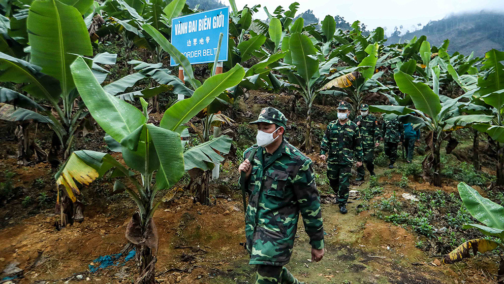 Border guard officers patrol the Vietnam-China border.