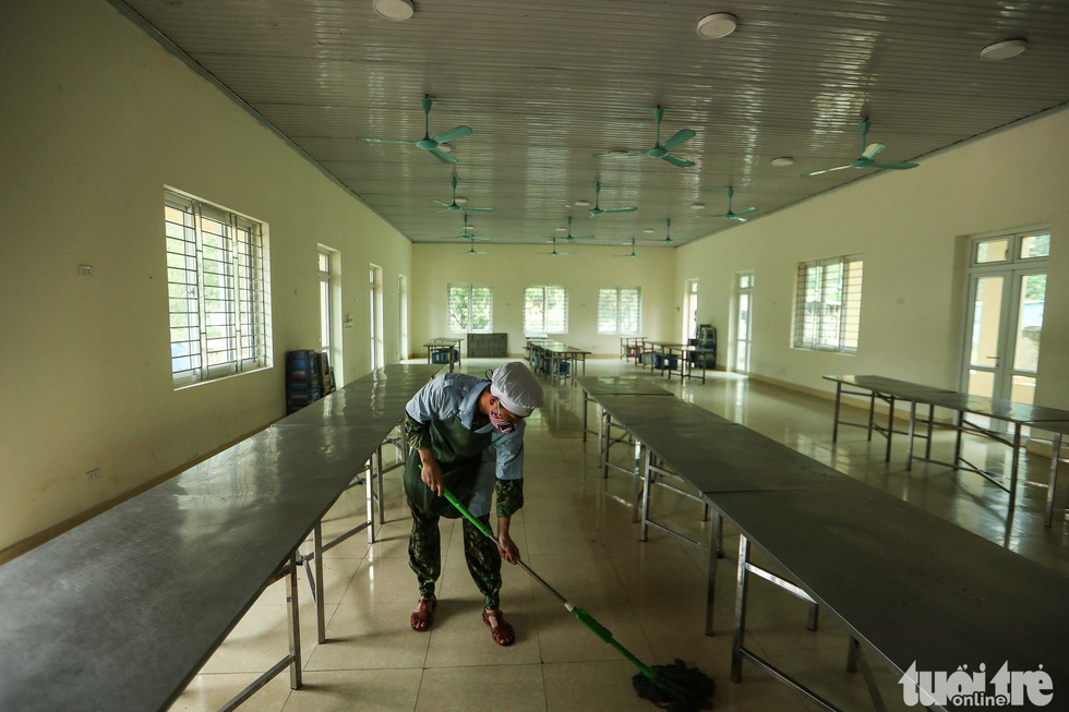 A military staff cleans a dining room at the Military School of Lao Cai Province in northern Vietnam. Photo: Nguyen Khanh / Tuoi Tre