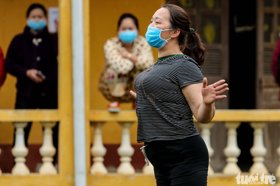 A woman in quarantine for the novel coronavirus dances to music at the Military School of Lao Cai Province in northern Vietnam. Photo: Nguyen Khanh / Tuoi Tre