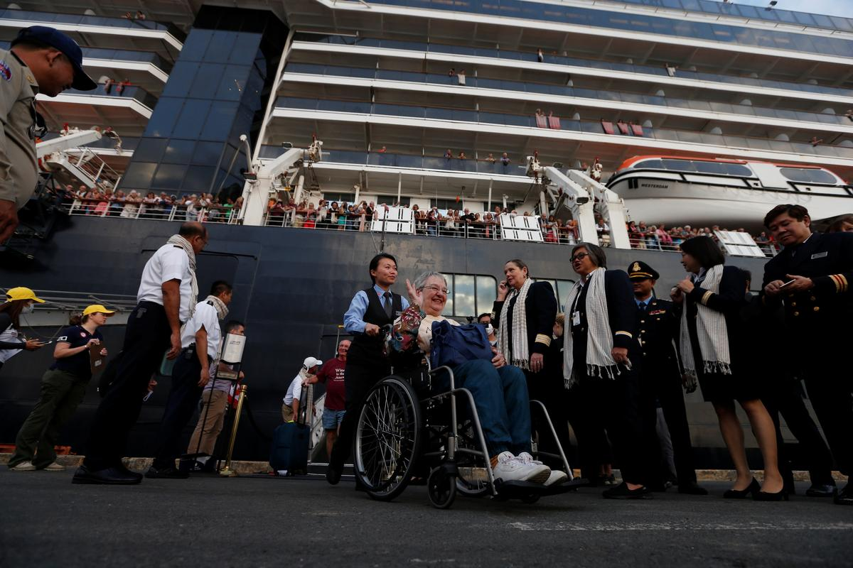 Passengers of MS Westerdam, a cruise ship that spent two weeks at sea after being turned away by five countries over fears that someone aboard might have the coronavirus, get off as it docks in Sihanoukville, Cambodia February 14, 2020.  Photo: Reuters