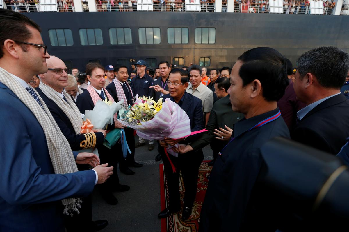 Cambodia's Prime Minister Hun Sen welcomes the passengers and crews of MS Westerdam, a cruise ship that spent two weeks at sea after being turned away by five countries over fears that someone aboard might have the coronavirus , as it docks in Sihanoukville, Cambodia February 14, 2020. Photo: Reuters