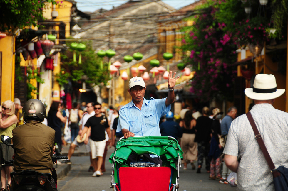 A man drives a cyclo on a street in Hoi An Ancient Town, located in the central province of Quang Nam, in February 2020. Photo: B.D. / Tuoi Tre