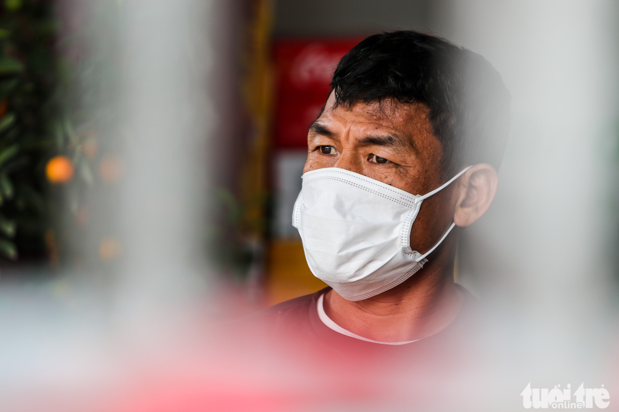 Nguyen Van Hung, a resident in Ai Van Village in Son Loi Commune, Binh Xuyen District, Vinh Phuc Province, Vietnam, is photographed wearing a face mask on February 11, 2020. Hung, whose family business has been affected by COVID-19, says he is concerned about not having enough face masks. Photo: Nguyen Khanh / Tuoi Tre