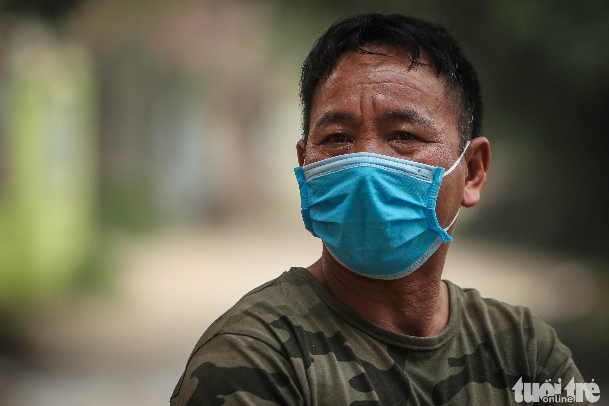 Pham Van Bon, a neighbor of a family in Son Loi Commune, Binh Xuyen District, Vinh Phuc Province, Vietnam with four members already infected with the novel coronavirus, is photographed wearing a face mask on February 11, 2020. Photo: Nguyen Khanh / Tuoi Tre