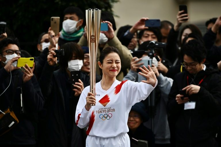 Tokyo holds Olympic torch rehearsal as spectre of virus looms