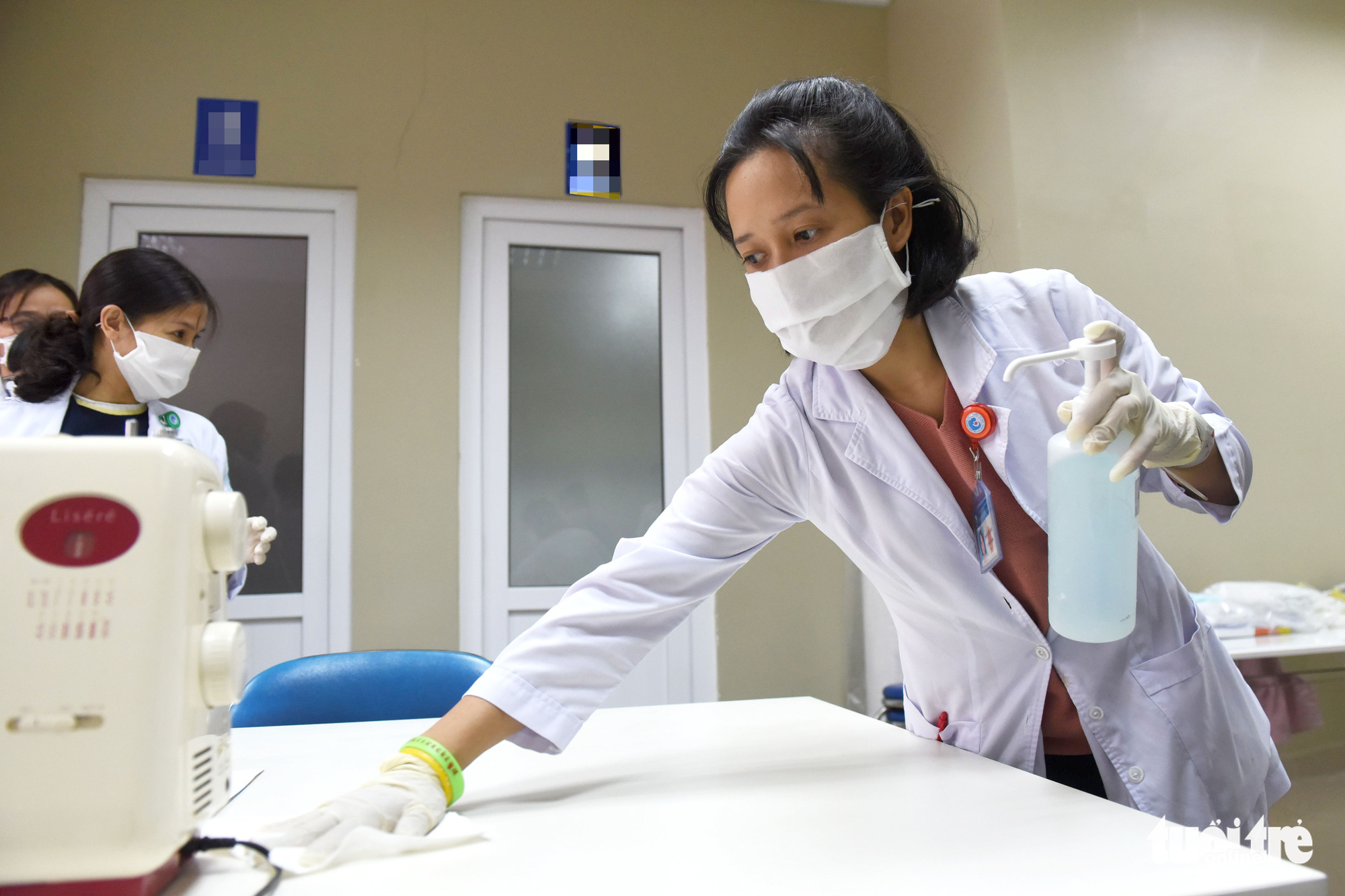 A health worker disinfects a table with alcohol before making face masks at Tu Du Maternity Hospital in Ho Chi Minh City, February 13, 2020. Photo: Duyen Phan / Tuoi Tre