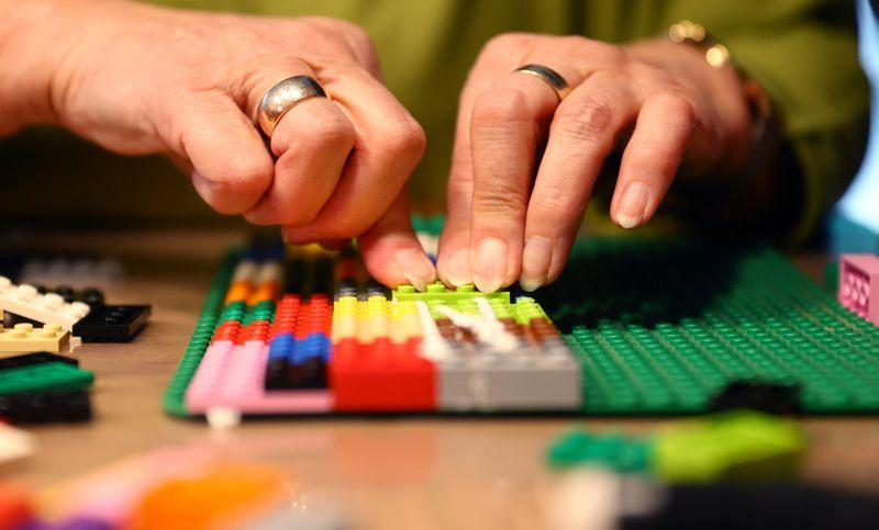 Rita Ebel, nicknamed 'Lego grandma,' builds a wheelchair ramp from donated Lego bricks in the living room of her flat in Hanau, Germany, February 17, 2020. Picture taken February 17, 2020. Ebel started to build the ramps almost one year ago to raise awareness for handicapped people in her hometown of Hanau. Meanwhile, dozens of stores use the ramps to ease entry for wheelchair users.  Photo: Reuters