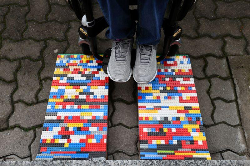 Rita Ebel, nicknamed 'Lego grandma,' tests one of her wheelchair ramps built from donated Lego bricks in Hanau, Germany, February 17, 2020. Picture taken February 17, 2020. Ebel started to build the ramps almost one year ago to raise awareness for handicapped people in her hometown of Hanau. Meanwhile, dozens of stores use the ramps to ease entry for wheelchair users.  Photo: Reuters