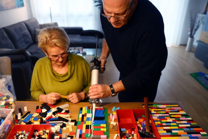 Rita Ebel (L), nicknamed 'Lego grandma,' and her husband Wolfgang build a wheelchair ramp from donated Lego bricks in the living room of their flat in Hanau, Germany, February 17, 2020. Picture taken February 17, 2020. Ebel started to build the ramps almost one year ago to raise awareness for handicapped people in her hometown of Hanau. Meanwhile, dozens of stores use the ramps to ease entry for wheelchair users.  Photo: Reuters