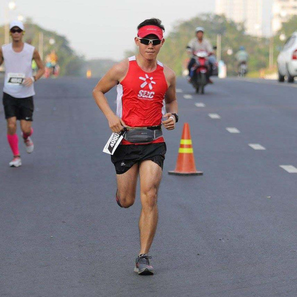Phan Thanh Tuan, founder of the Sunday Running Club with thousands of members, wears an SRC uniform while joining a run in this supplied photo.
