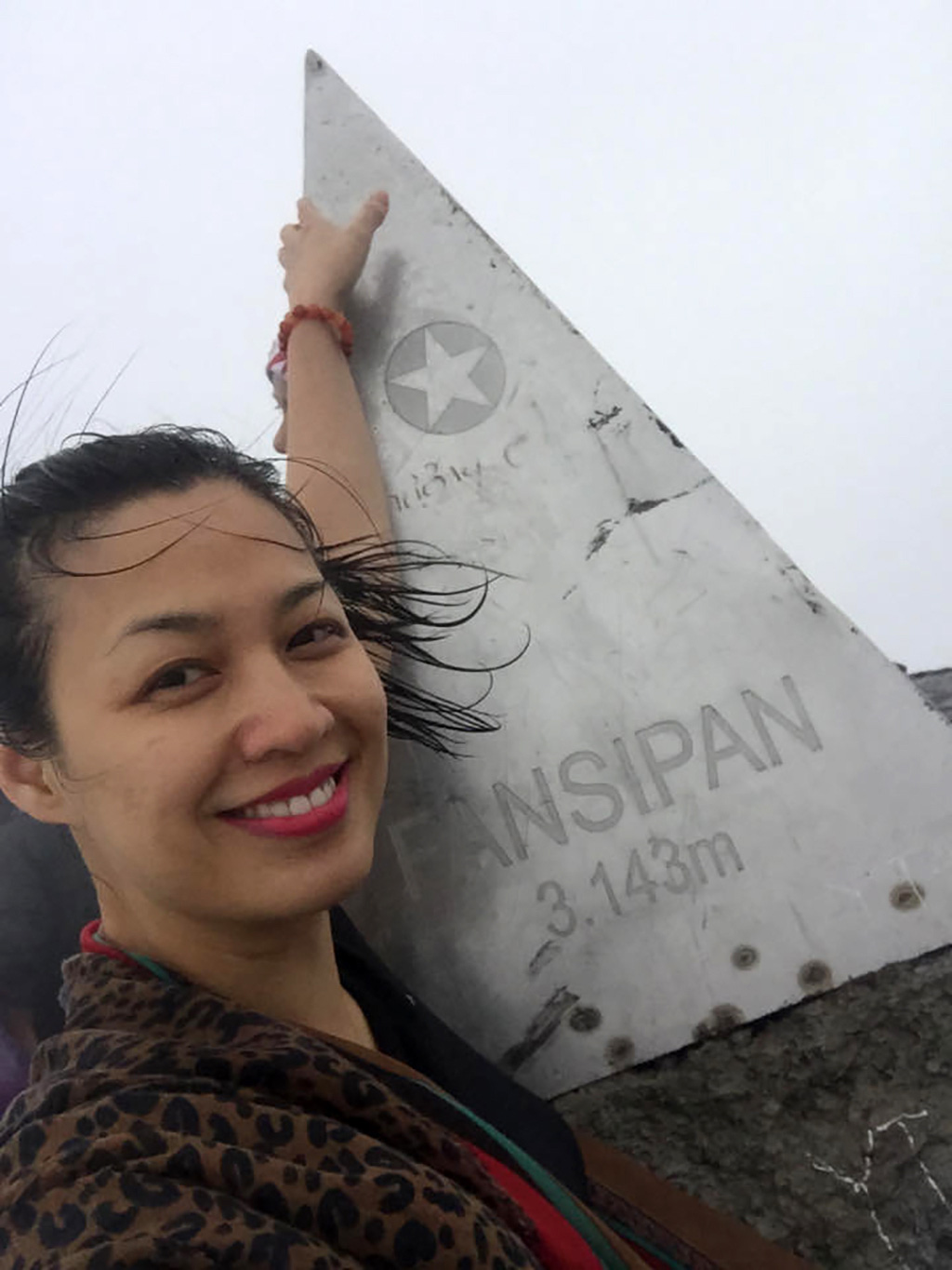 Bui Thanh Dung is seen in a 'selfie' taken on the Fansipan summit, Vietnam's tallest peak, on her first trek in this provided photo.