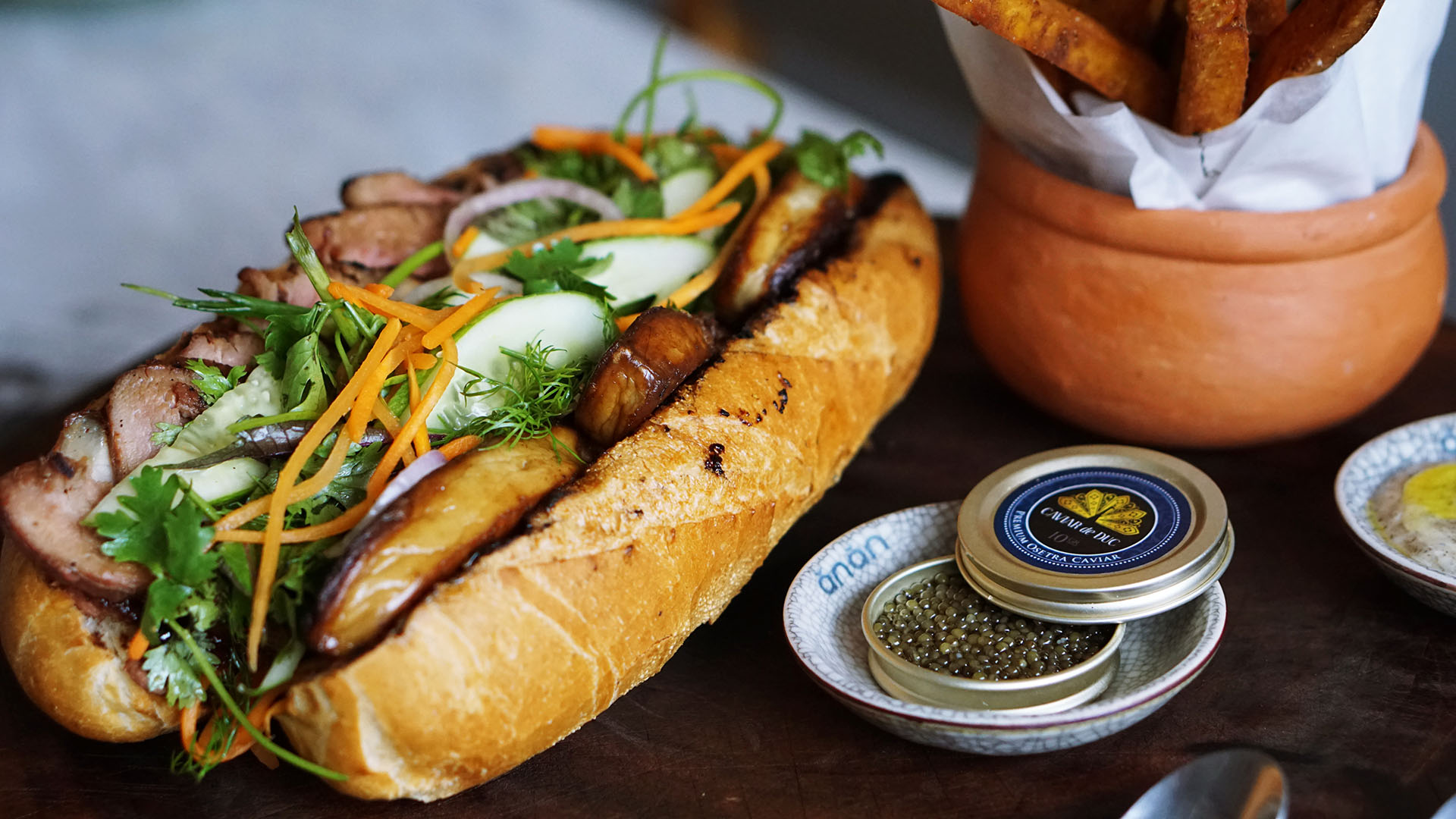 This acclaimed chef is selling $100 'banh mi,' 'pho' in Vietnam