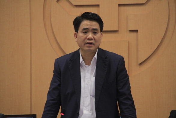 Hanoi chairman Nguyen Duc Chung speaks at a meeting on COVID-19 prevention and control on February 28, 2020. Photo: XL / Tuoi Tre