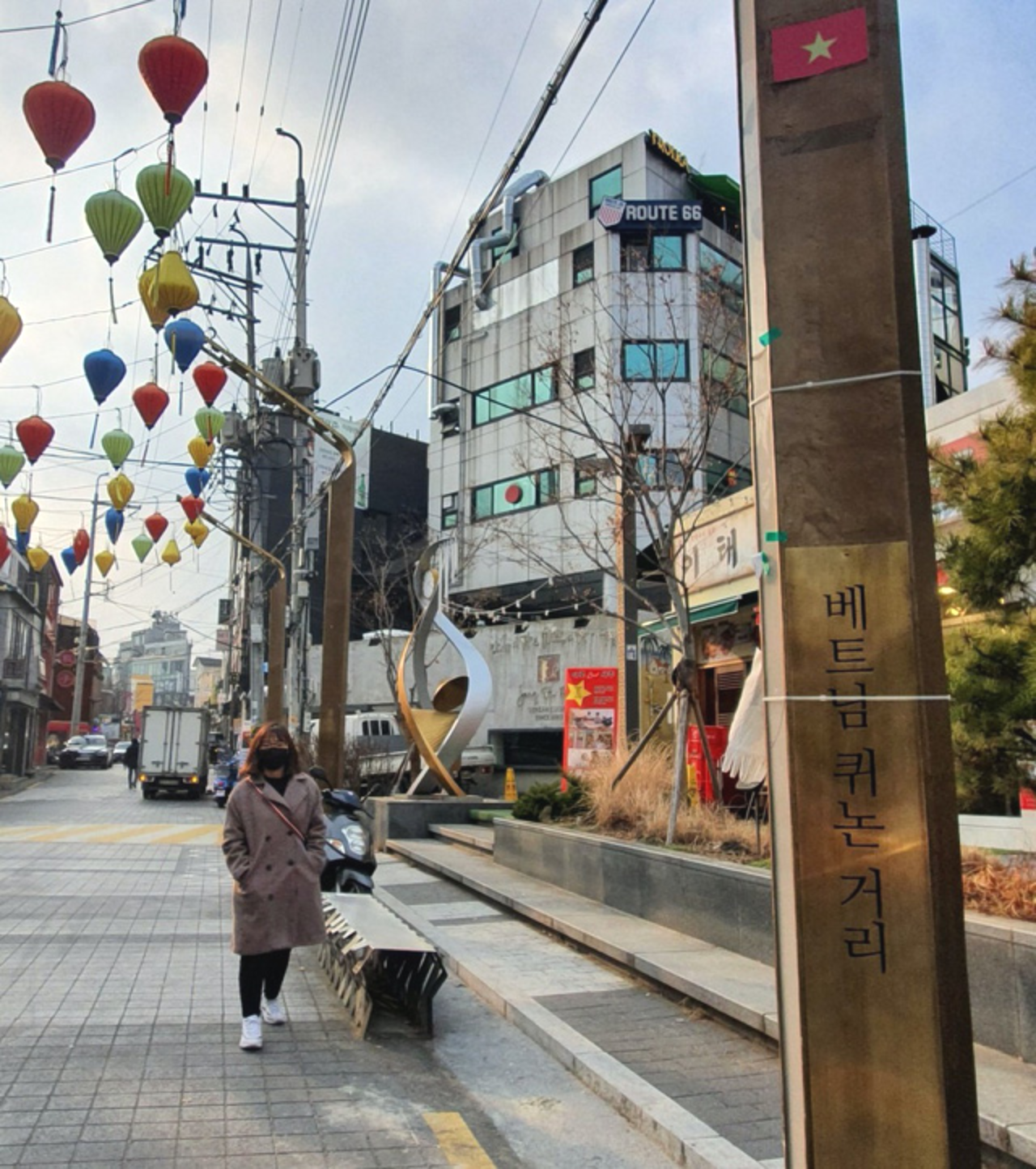 "A street in Itaewon is named for Quy Nhon, a coastal city in the south-central province of Binh Dinh Province. The Korean words on the signboard in the photo litarally says ""Quy Nhon Street, Vietnam"". This theme street is about 300 meters long and connects to a flower garden also called Quy Nhon. Photo: Le Dung / Tuoi Tre"