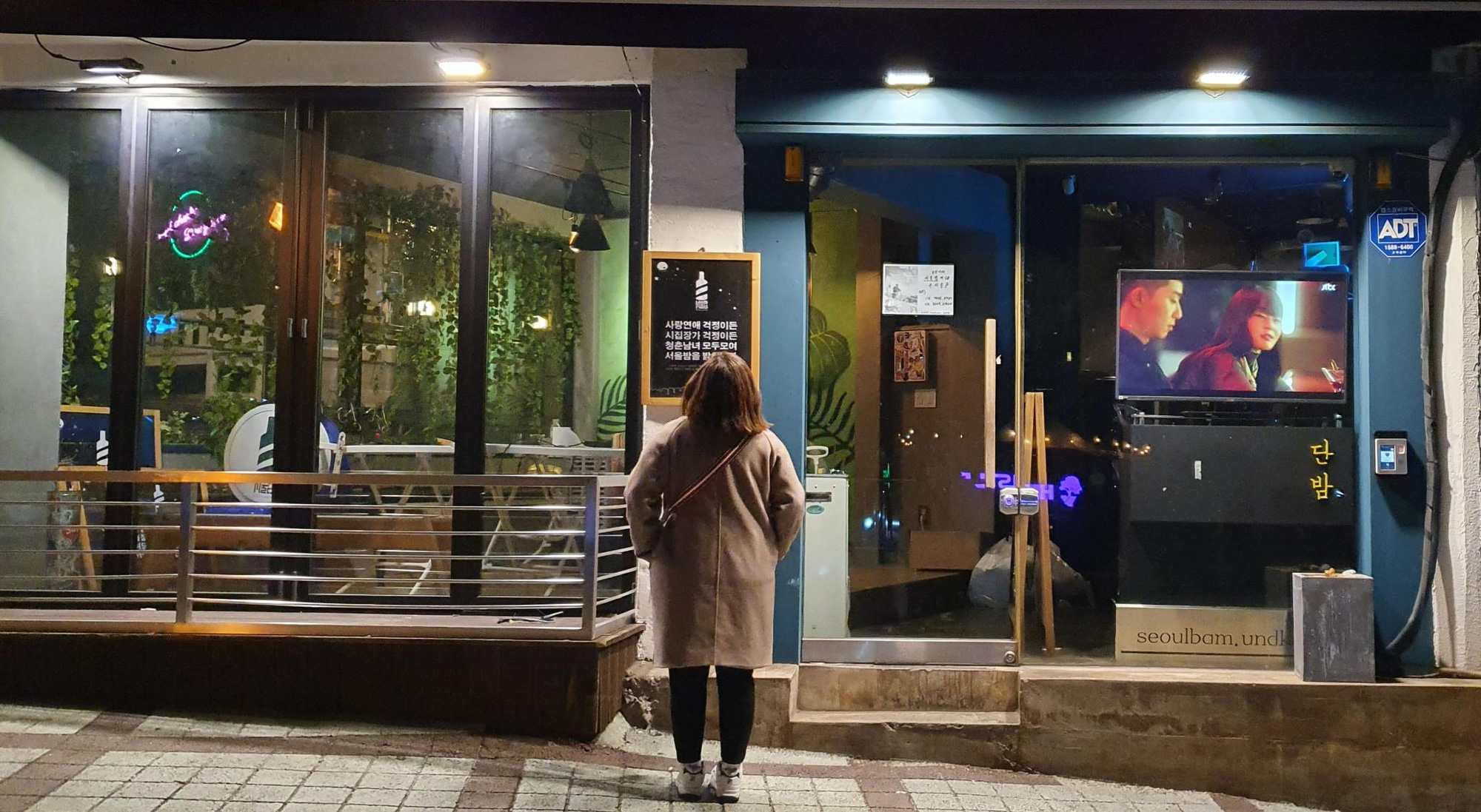 A screen is set up outside the DanBam bar-restaurant to air 'Itaewon Class' at night. For a long time, the real-life restaurant has been closed for renovation. Its owner is planning to reopen the venue in the near future and rename it Seoul Night. Photo: Le Dung / Tuoi Tre
